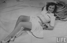Actress Paulette Goddard in rickrack-bordered white romper and. Classic Actresses, Hollywood Actresses, White Romper, White Dress, Paulette Goddard, Woman Movie, Norma Jeane, Leggings, Bathing Beauties