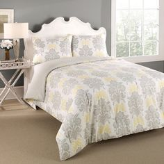 @Overstock.com - Laura Ashley Tatton 3-piece Reversible Comforter Set - This bright comforter features beautiful damask pattern in soft grey and sunny yellow, reversing to soft grey foulard print. The machine washable set includes shams.    http://www.overstock.com/Bedding-Bath/Laura-Ashley-Tatton-3-piece-Reversible-Comforter-Set/8473652/product.html?CID=214117  $119.99