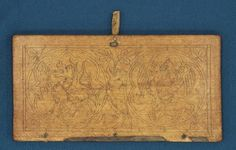 Carved or pyrographed cover. Wax tablets of the town of Torun (Poland). Poliptych M, tablet XIV, 1r. The upper cover. Incised ornament in the 13th century.