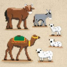 This tender Nativity scene features the Holy Family, 3 Wise Men, 2 shepherds, the angel, and a host of animals in mini beads. Designed by Kyle McCoy. Perler Bead Designs, Pearler Bead Patterns, Perler Patterns, Hama Beads Animals, Hama Beads Disney, Christmas Perler Beads, Nativity Crafts, Christmas Nativity, Beading For Kids
