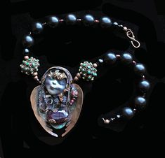 OOAK, Handmade Observant Figure W/ Large Natural Faceted Ruby Cabochon: Solid Brass beads with Inlaid Turquoise, Copper, Onyx & Black Wood