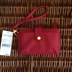 """Steve Madden Wristlet Steve Madden Red pebbled leather phone case/wallet/wristlet! Zippered coin storage, id slot and snap pocket. Fits the iPhone 5 with a slimline case (or no case at all). Or simply use as a cute handy wallet! 6.5"""" x 4""""! 20% off bundles. Steve Madden Bags Clutches & Wristlets"""