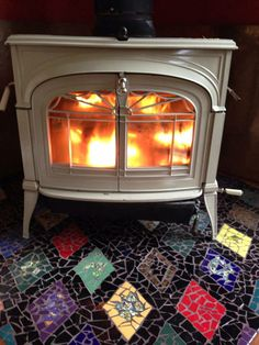 Mosaic floor under  wood stove. - would use different colors - but love that white stove1