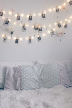 room decor idea with fairy lights or string lights polaroid pictures and fake flowers