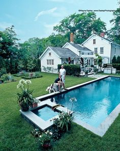 Designers John Dransfield (r) and Geoffrey Ross by the pool at their East Hampton home.