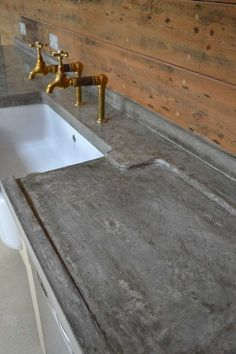 Detail of cast in situ polished concrete worktop with sloped drainer and beautiful marbling