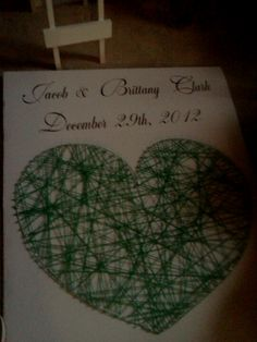 Heart made on poster boards out of tacks and yarn!