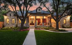 twilight architectural photography with porch and tin roof and the house of stone