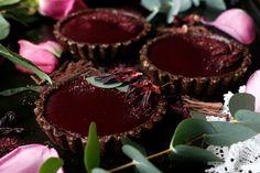 Raspberry Hibiscus Chocolate Tarts Recipe. Wholesome grain-free vegan decadent chocolate tarts with hibiscus raspberry jelly.