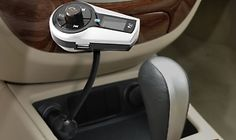 Aduro Stereo Bluetooth FM Transmitter Car Kit with Remote. Uses cigarette lighter, so very cool if you have an older car without USB port access. Can listen to smartphone/MP3 player via car speakers!