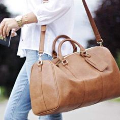 """✨""""IT GIRL"""" HP! ✨ Coach Leather Overnight Duffel Coach Tan Leather Overnight Duffel bag, Like New excellent condition, hardly used. Still has Original Coach Leather smell.  measures 23"""" across by 16"""" flat, has semi-hard flat bottom with detachable adjustable shoulder strap. Leather is super soft and bag has lots of space. Any questions or need more pics, please ask! Serious inquires only please!  Posh Sales Only  Fast Shipper  5-Star posher  Price firm at $250 unless bundled  ✨✨l Coach Bags"""