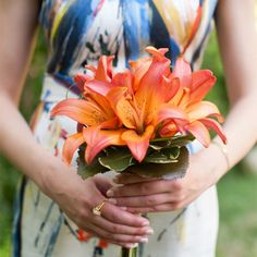 Orange Tiger Lily Bridesmaid Bouquet // Jenny DeMarco Photography // Bouquets Of Austin // http://www.theknot.com/weddings/album/a-romantic-outdoor-wedding-in-austin-tx-137404