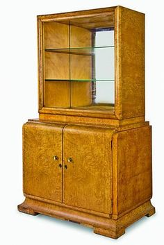 A French Art Deco period display cabinet in birds eye maple