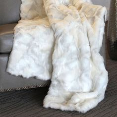 Handcrafted faux fur throw in snow bunny with velvet lining.  Product: ThrowConstruction Material: Acrylic< and ...