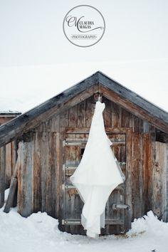 A great idea... for a rustic wedding photo of the gown... Winter Wedding Austria Claudia Magas Photography