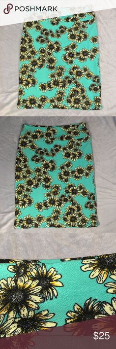 """Lularoe XL Cassie pencil straight skirt sunflowers Good to excellent overall condition no flaws noted.   Women's size XL Lularoe Cassie skirt.  Sunflowers  Measurements are approximate with the garment laid flat  Waist 17"""" Length 25.75"""" LuLaRoe Skirts Pencil"""