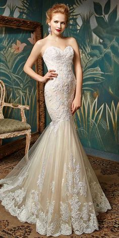 Get lost in the loveliest lace. This full-length mermaid gown features the sweetest delicate beaded lace appliques along with intricate corded lace and soft tulle. A strapless sweetheart neckline is just one classically elegant highlight. Pearl buttons along the back zipper give Jin an even more timelessly romantic feel.