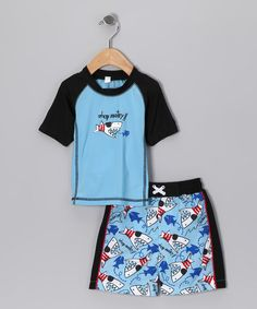 Take a look at this Baby Buns Blue Pirate Shark Rashguard & Swim Trunks - Toddler by Baby Buns on #zulily today!