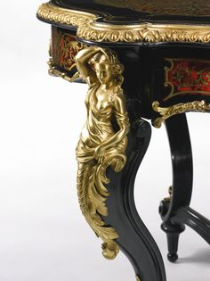 c1870-80 A NAPOLÉON III GILT BRONZE MOUNTED EBONIZED AND BOULLE STYLE BRASS INLAY AND TORTOISESHELL MARQUETRY CENTER TABLE  Paris, circa 1870's  Estimate   8,000 — 12,000  USD   LOT SOLD. 23,750 USD (Hammer Price with Buyer's Premium)