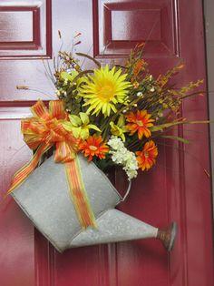 Front door wreath alternative using an antique watering can