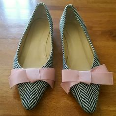 J Crew Flats Sweet herringbone pattern tweed Flats with darling pink bow. These versatile flats would look great with a sun dress or dress up a pair of jeans. Super comfortable. Great used condition. J Crew  Shoes Flats & Loafers