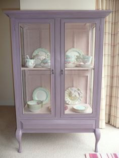 Shabby chic vintage glass display cabinet painted with Annie Sloan colours - Emile on the outside and Antoinette on the inside. #shabbychiccabinets