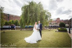 bride and groom pose for portrait on their wedding day in Castlefield
