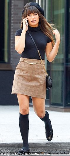 Knee-high theme: Lea donned knee high socks with flats with her new outfit