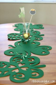 "How to make a ""No Sew"" Shamrock Table Runner for St. Patrick's Day.  Just tie Dollar Store placemats together with ribbon."