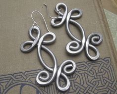 Big Celtic Earrings - Double Swirl Shamrock Whirl - Celtic Jewelry- Light Weight Hammered Aluminum Dangle -Big Earrings -Bold. $18.00, via Etsy.