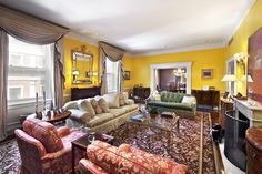 Living room in a co-op for sale at 7.8M at 550 Park Avenue on the Upper East Side.  This is a prestigious building which was the former home of Kitty Bache Miller and Diana Vreeland among other notables.