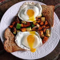 The breakfast of champions // sweet potato + zucchini + mushroom hash, fried eggs  & toast to sop up all the yolk  FACEPLANTING