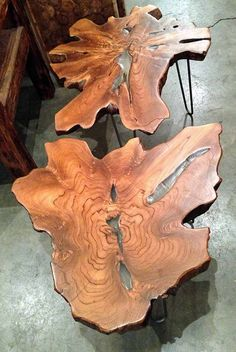 A side table (or coffee table or stools) made from a reclaimed old growth teak tree trunk section and steel hairpin legs and resin. By Impact Imports of Boise & Philadelphia.