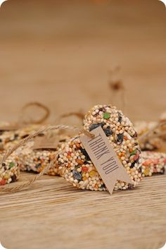bird seed ornaments... would be fun and easy for the girls to make and hang in our tree.