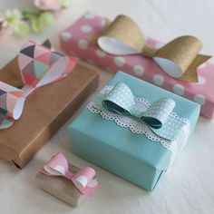 Print your own scandinavian gift wrap and learn how to make pretty tissue poms, paper bows and simple gift bags with designer and maker Lia Griffith.