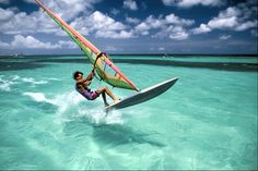Windsurfing, also called board sailing, is an exciting and exhilarating water sport combining the elements of sailing, surfing and characteristics of skateboarding, snowboarding, wakeboarding and waterskiing! Several pieces of gear are required before you can begin  windsurfing......