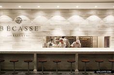 Bécasse Bakery has a mouth watering patisserie selection, showcased on stone bench tops under glass cabinets. Cafe Restaurant, Restaurant Design, Westfield Sydney, Bakery Display, Stone Bench, Bakery Design, Commercial Kitchen, Stone Tiles, Architecture Design