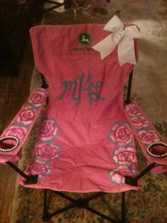 HILARIOUS!!  Want this!! It's too perfect: it is pink...it has pearls...it is monogramed, it has a bow...and a John Deere logo.  HOWLING!