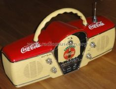 "Coca Cola AM/FM ""Boom Box"" with ""Stereo Radio Cassette"", in form of classic 1957 Chevy Bel Air convertible dashboard (car interior) with its steering wheel as a handle, speedometer tuner and car antenna. Also the knobs are retro. Coca Cola Life, Coca Cola Ad, Always Coca Cola, World Of Coca Cola, Coca Cola Bottles, Radios, Tvs, Coca Cola Decor, Vintage Coca Cola"