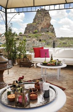 Hezen Cave Hotel in Cappadocia-Turkey.  The carved-stone terrace overlooks Ortahisar's giant rock castle and other-worldly landscape.