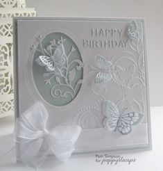 poppystamps dies are theo butterfly, whidbey butterfly, and elsa butterfly branch thats in the oval and last the Happy Birthday background die (990)