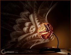 Creative ways to light up a room with amazing exotic gourd Lamps by Calabarte. Each gourd lamp is made from a gourd brought from Senegal and their exotic design is achieved after carefully selecting dried shells of gourd fruit and drilling patterns into them.