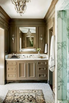 We love the dark color in this classic bathroom. It radiants warmth and cozies up the cool marble countertop and tile floor.  #summer #vibes #currentlycoveting