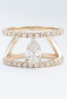Brides.com: . Custom double-band engagement ring with a pear-cut white diamond and white diamond pavé set in 14K yellow gold, price upon request, Mociun