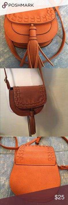 """Perfect Cognac Mid-sized Just Fab Crossbody Bag Perfect mid-sized cognac colored Just Fab crossbody bag with magnetic closure & tassel detail, new without tags, measures 8"""" x 8"""" x 3.5"""". Bags Crossbody Bags"""
