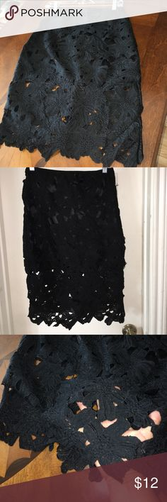 Black lace pencil skirt Black lace pencil skirt Size small. The skirt is aligned to the miniskirt line the bottom half is see-through as seen in pictures Skirts Pencil