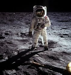 A teensy-tiny Neil Armstrong is visible in the helmet of Buzz Aldrin during the Apollo 11 landing in July 1969. NASA
