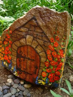 painted rock garden | Fairy House painted on a rock