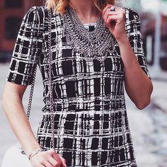 @Kaitness is wearing the Plaid with an Edge dress from Fevrie and styling it with some chic accessories!