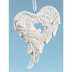 Here is a pair of wings holding a baby shaped like a heart.  Won't that make a wonderful Christmas gift for a new mother or a heart collector.